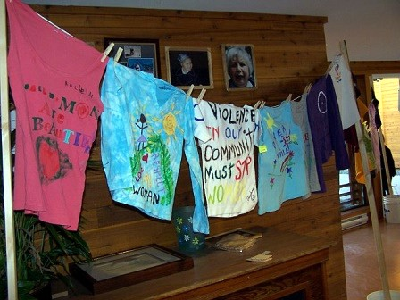 The IWD Clothesline Project:  Participants painted anti-violence messages on shirts and they were hung in the Band Office foyer for two weeks.