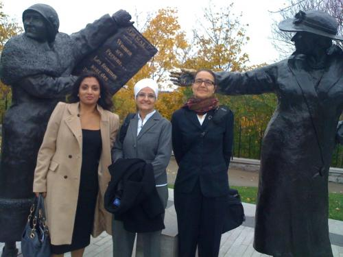 L-R: Kamaljit Lehal, Harjit Kaur, and Gisela Ruebsaat stand in front of the Women Are Persons! Monument located on Parliament Hill in Ottawa.